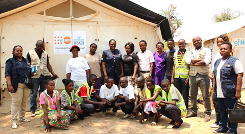 Community based volunteers in Mantapala refugee settlement pose for a photo with UNFPA Zambia Representative, Ms. Gift Malunga and UNFPA staff during a monitoring visit in September 2018.